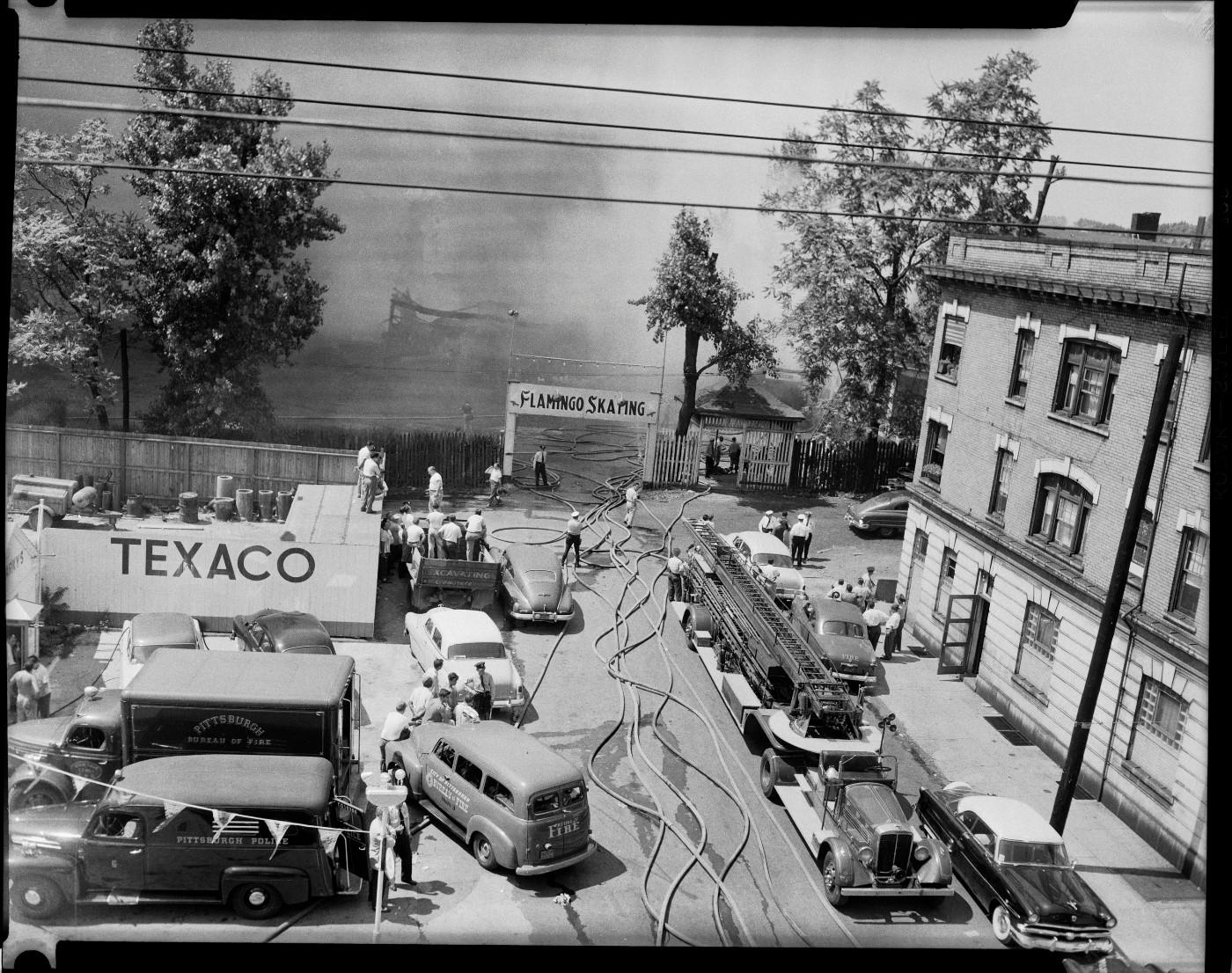 "Charles ""Teenie"" Harris, 'Fire fighters battling fire at Flamingo Skating rink, Larimer and Auburn Avenues, East Liberty,' July 1954"