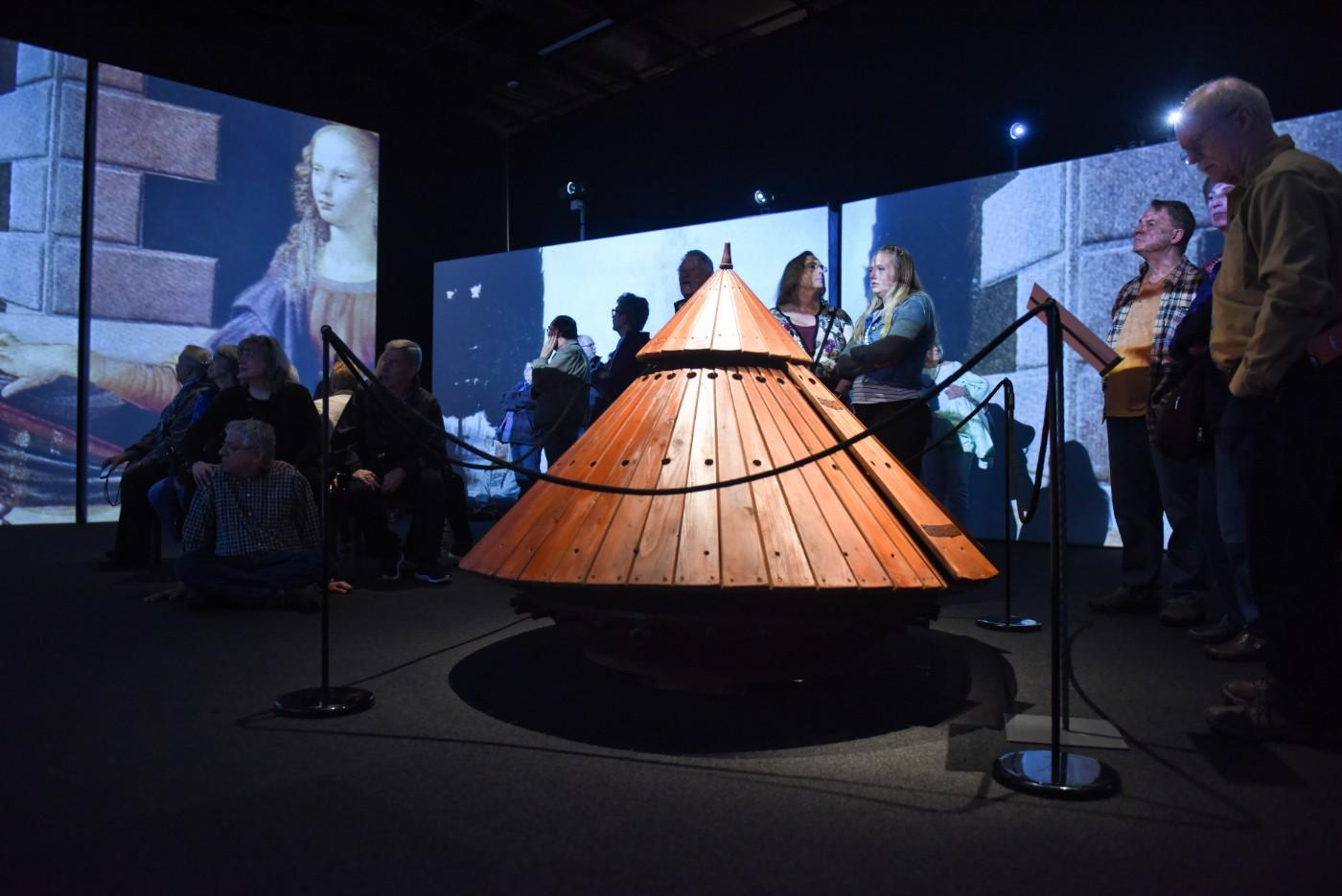 Visitors explore interactive models of da Vinci's inventions.