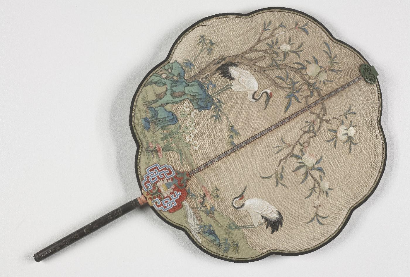 Lobed fan with cranes, peaches, and rocks