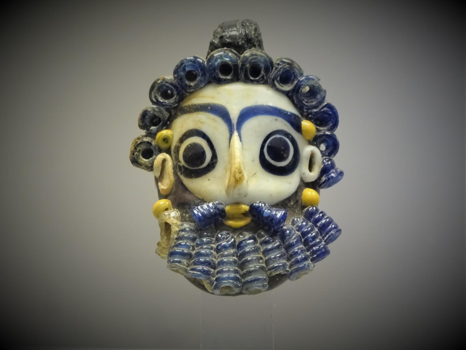Glass pendant, 4th or 3rd century BC.