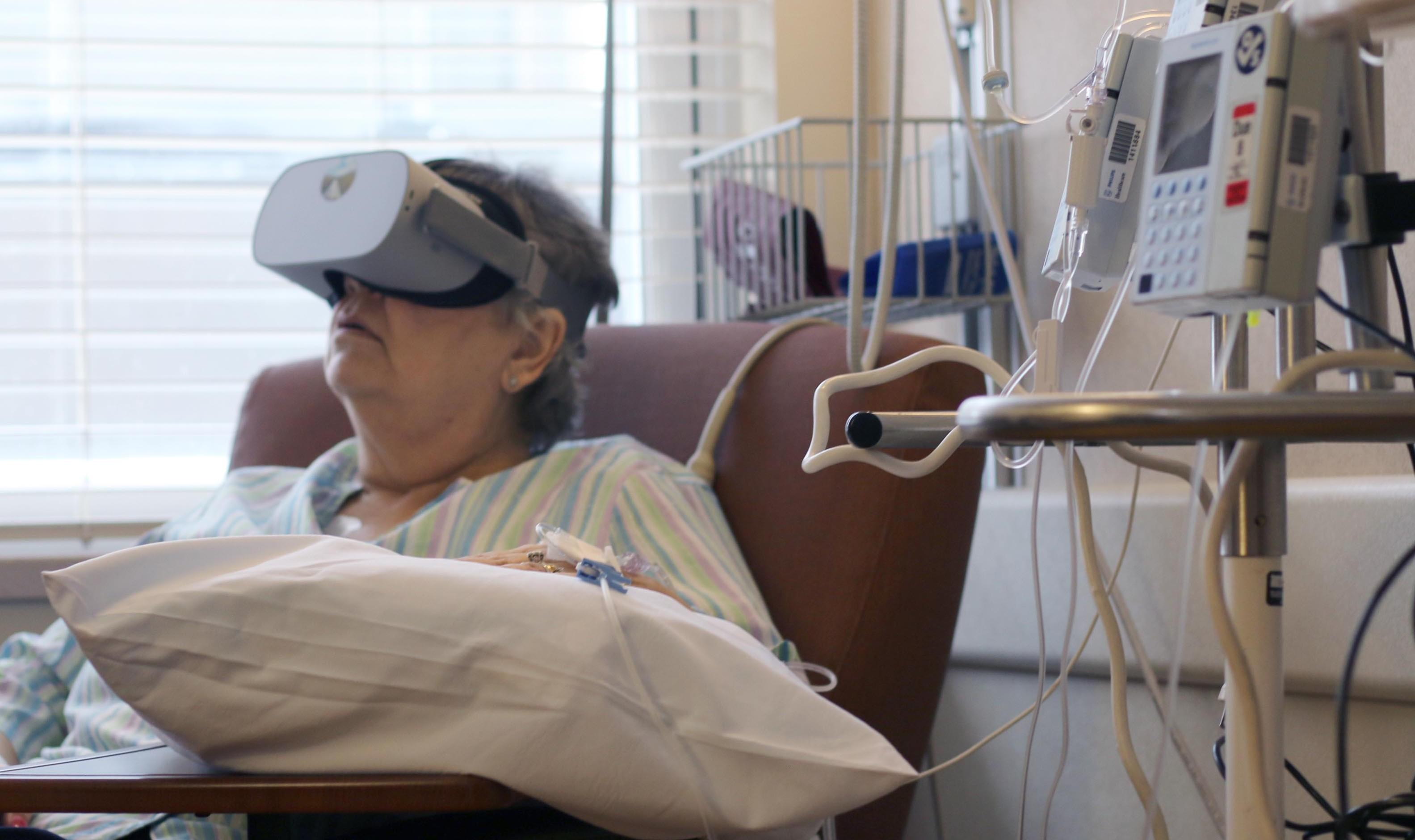A patient receiving chemo treatments uses VR.