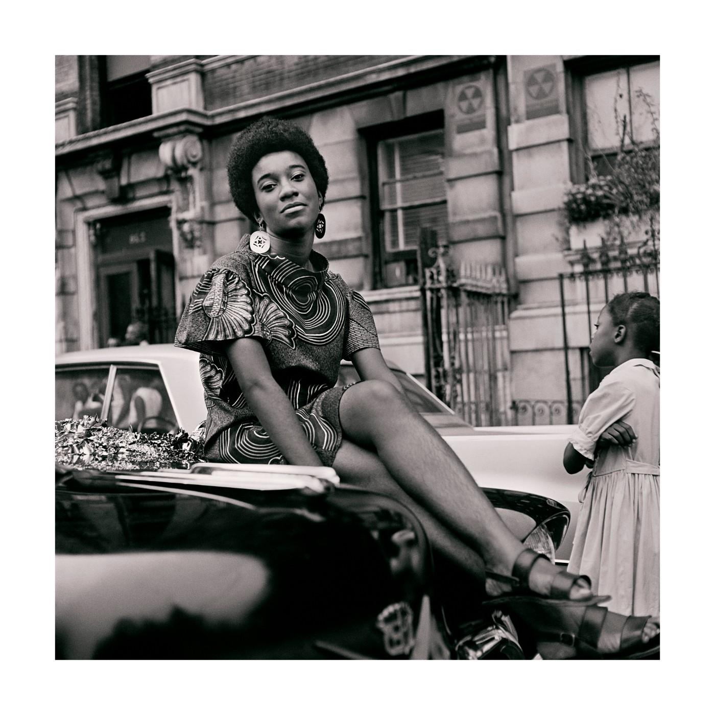 Kwame Brathwaite. Grandassa Model on car during Marcus Garvey Day celebration, Harlem, ca. 1968.