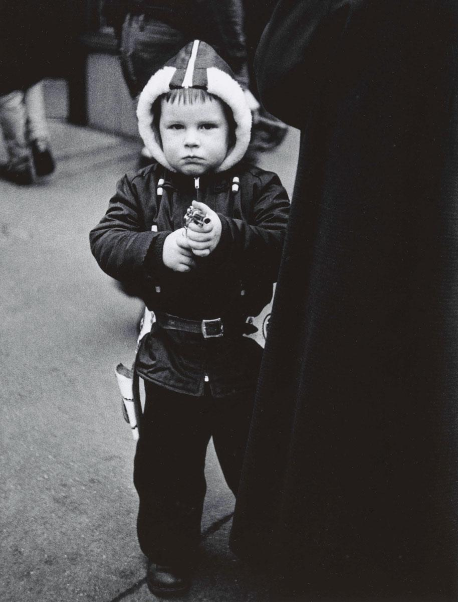 Kid in a hooded jacket aiming a gun, N.Y.C. 1957