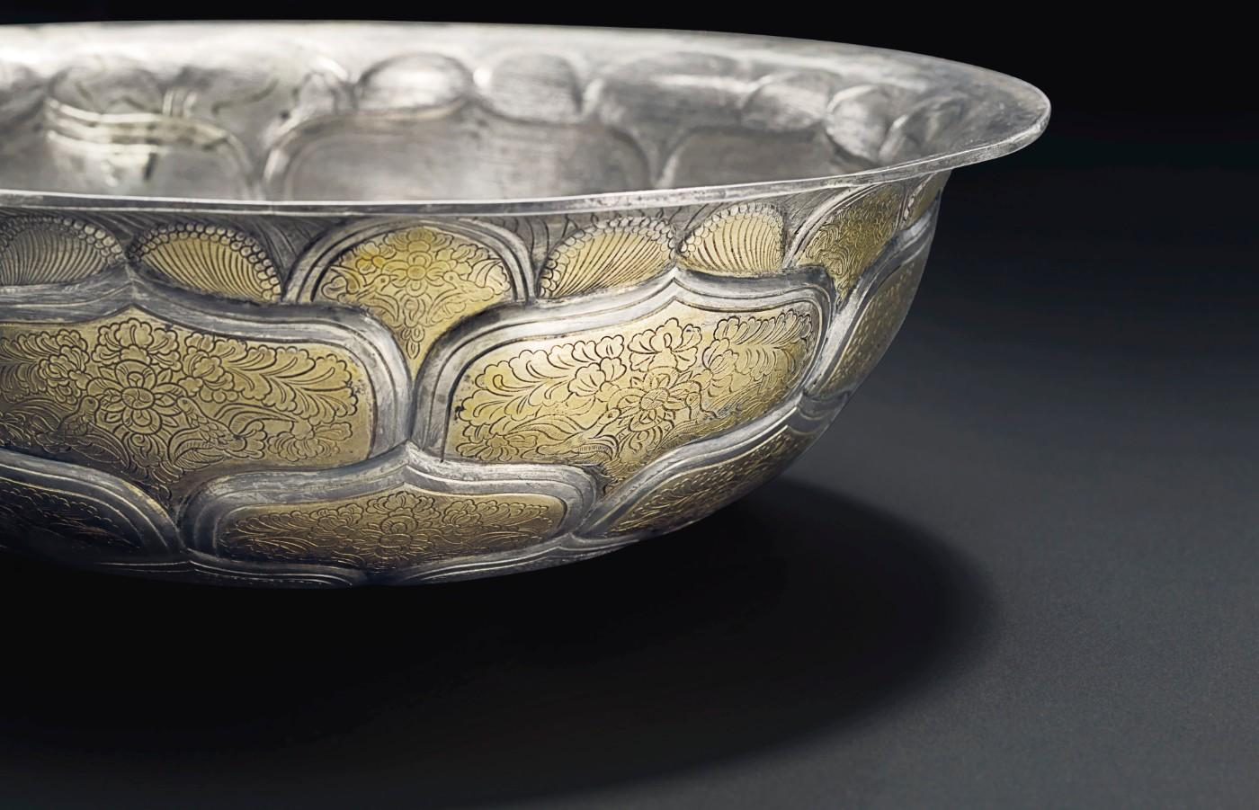 A very rare and important large parcel-gilt silver bowl, Tang dynasty (AD 618-907). Diameter 9⅝ in. Sold for $3,495,000.
