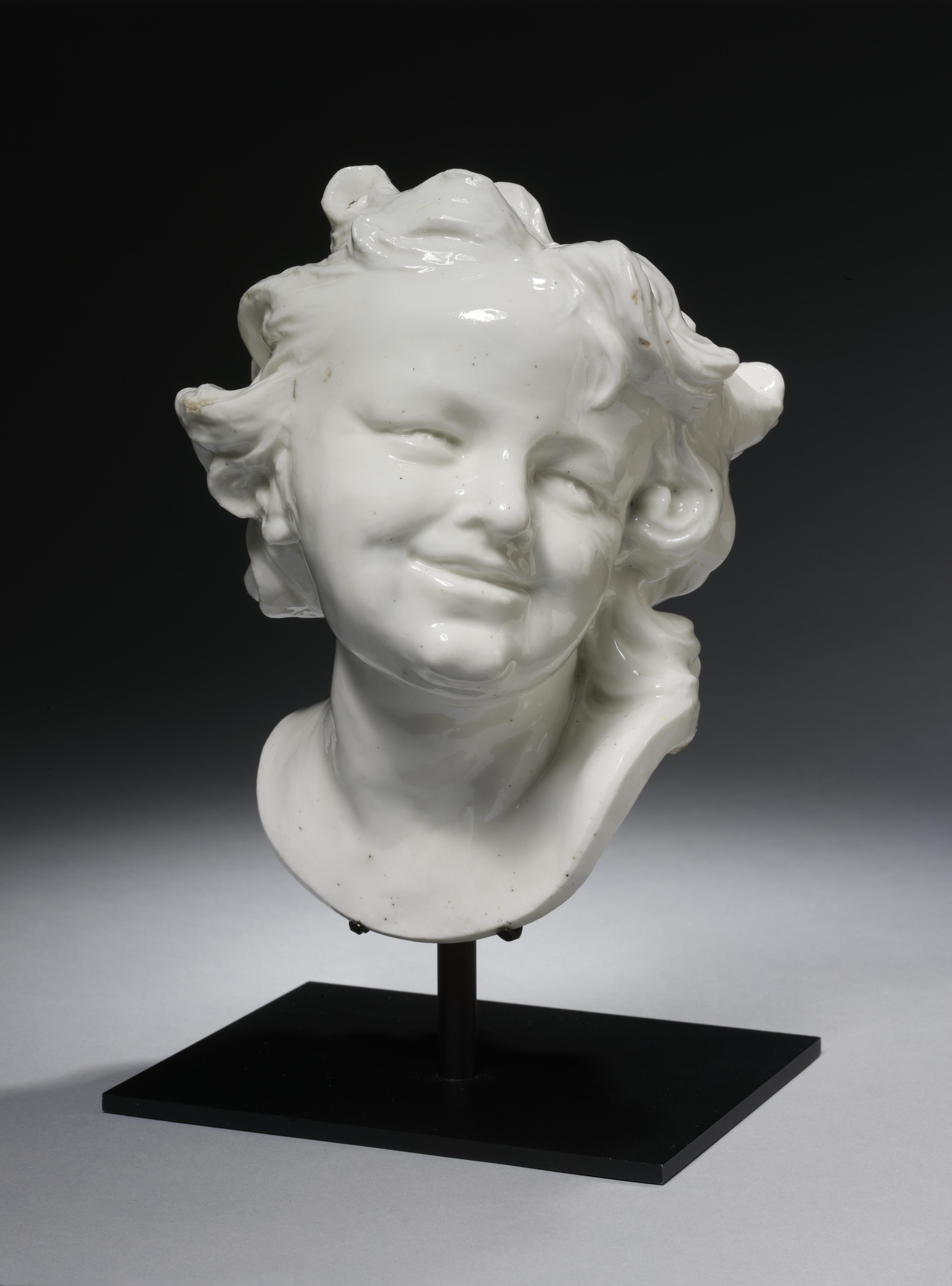 ceramic bust of a laughing child