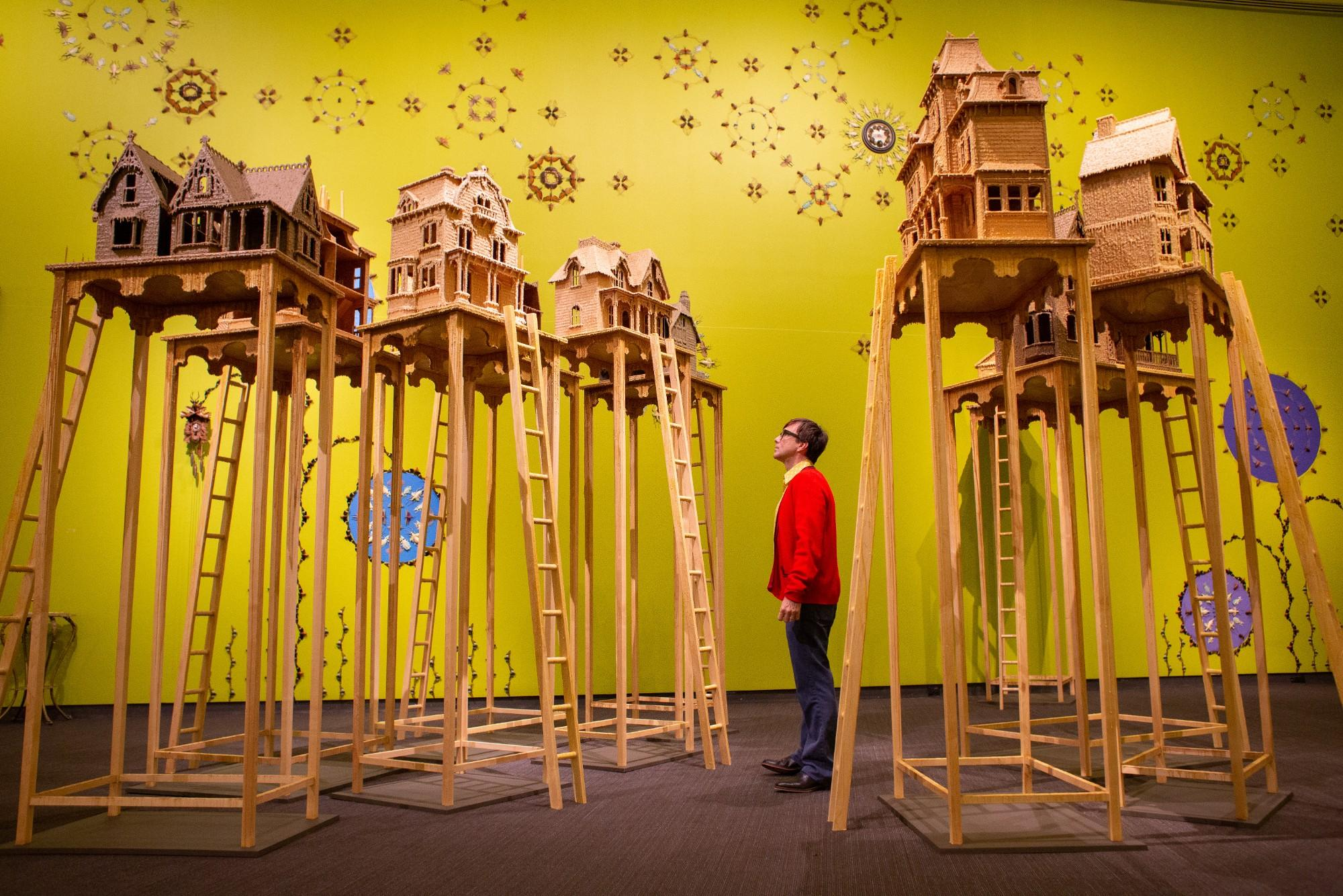Jennifer Angus installation featuring Victorian dollhouses covered in beeswax.