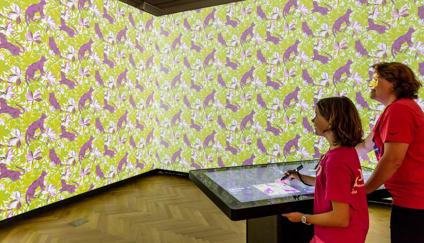 Visitors manipulate the walls using digital technology in the Immersion room at the Cooper Hewitt Smithsonian Design Museum.