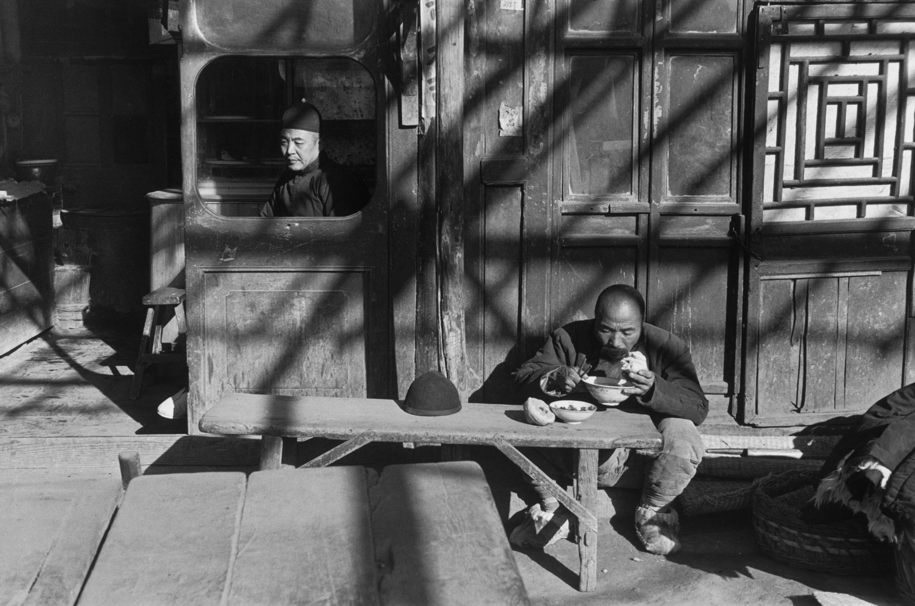At the entrance to a tavern, Beijing, December 1948.