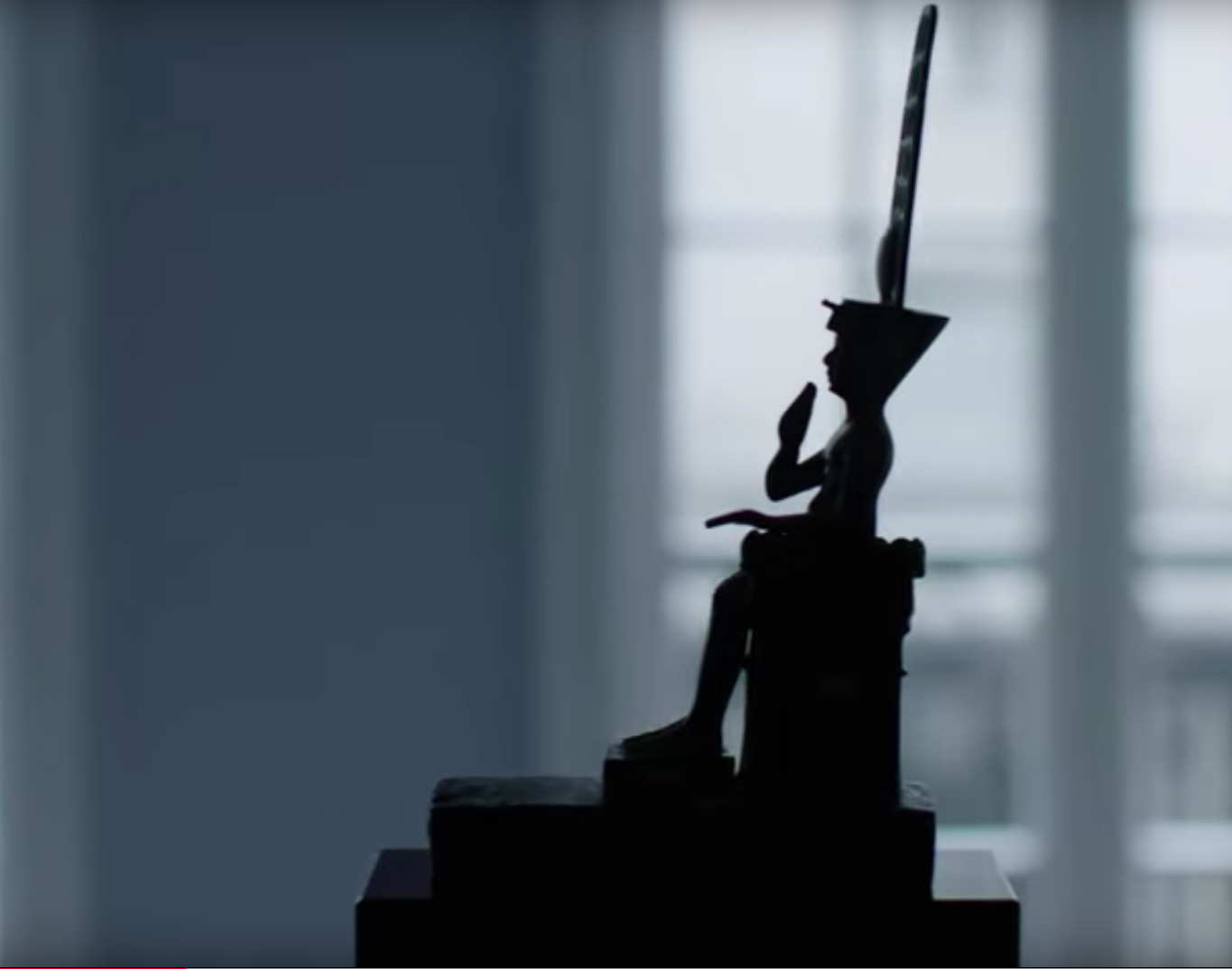 Silhouette of seated Egyptian bronze