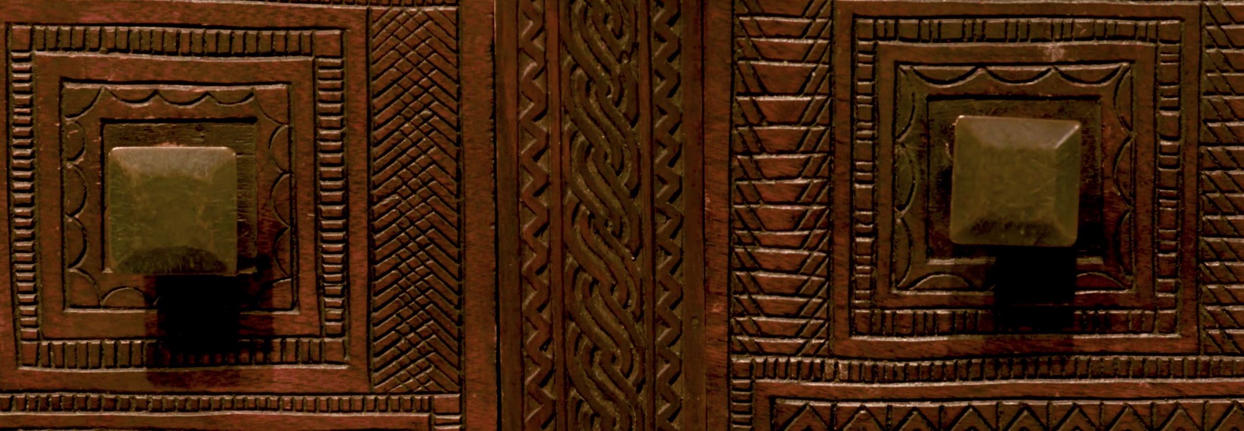 Detail of carved chest, showing two knobs