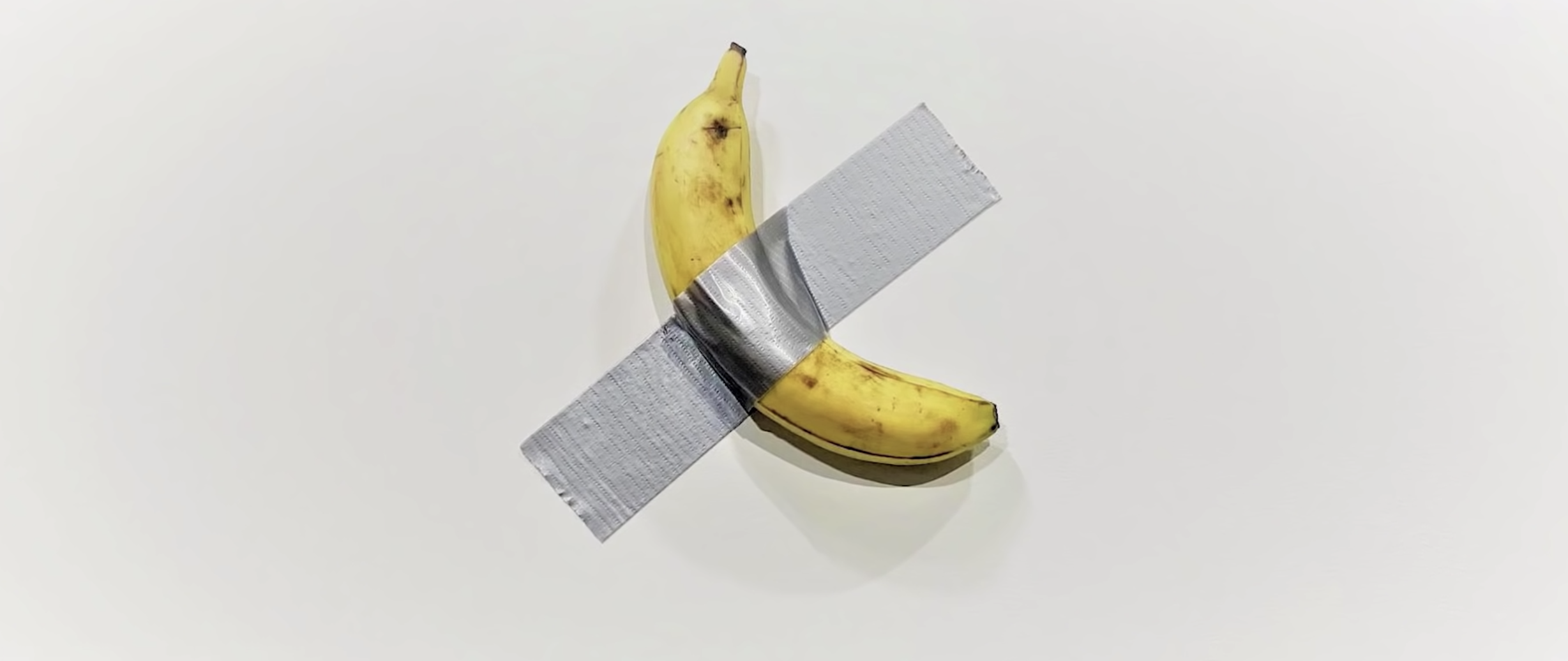 Artist Maurizio Cattelan's duct taped banana to a wall