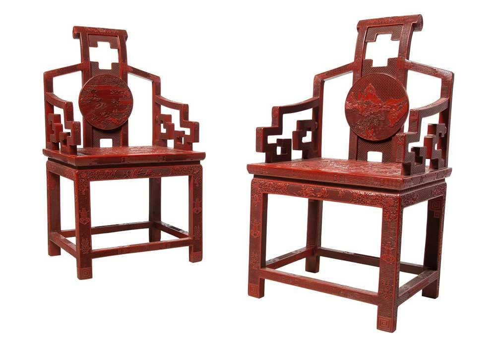 An Exceptional Pair of Chinese Carved Cinnabar Lacquer Court Chairs with Peony and Landscape Motifs