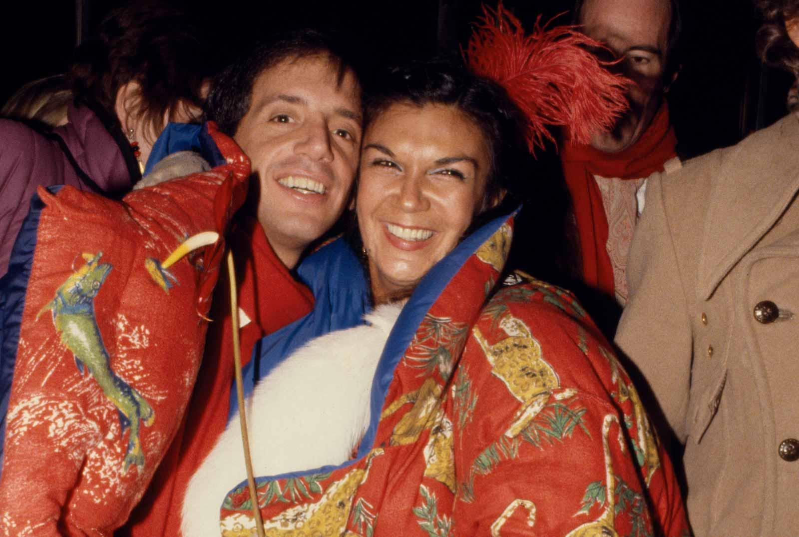Steve Rubell and Carmen d'Alessio in Norma Kamali coats, 1977.