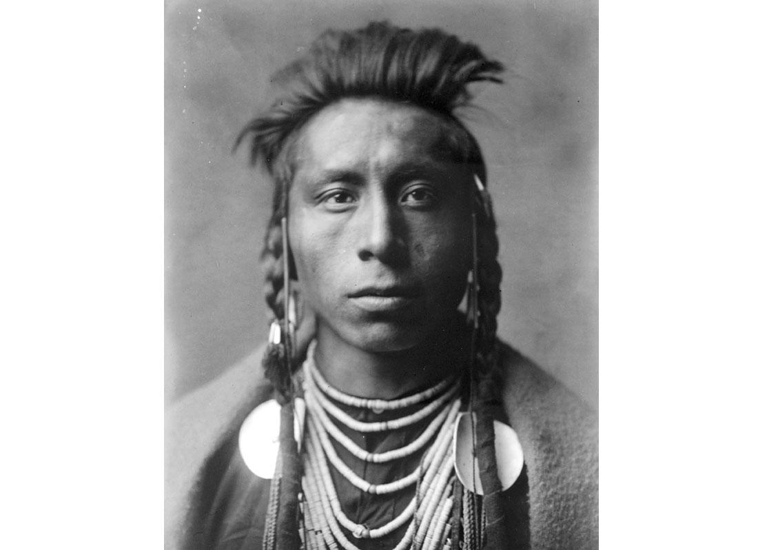 Lies Sideway. Head-and-shoulders portrait of Crow man, 1908.