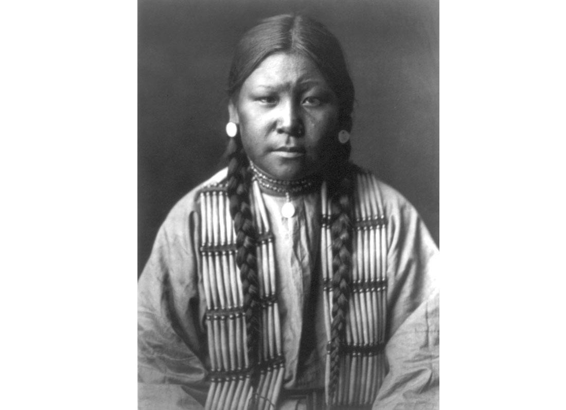 Cheyenne girl, half-length portrait, facing front, 1905.