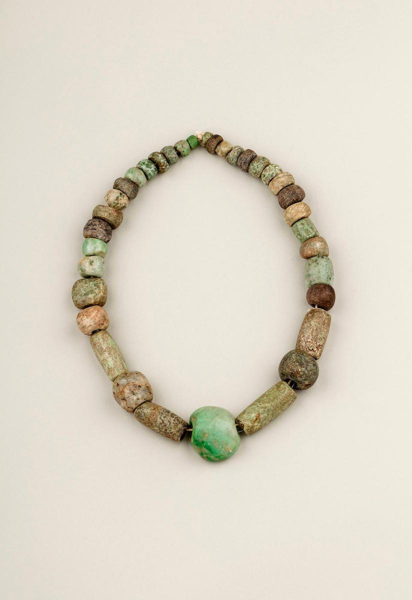 Frida Kahlo's string of irregular Pre-Columbian jade beads with a central pendant carved as a fist. Probably excavated from a Maya site.