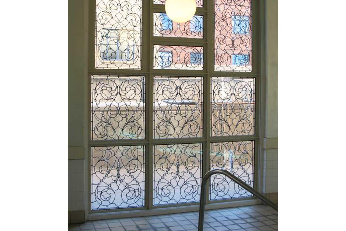 Without the use of color, Wolff is able to add intrigue and dimension to a window through her intricate designs.