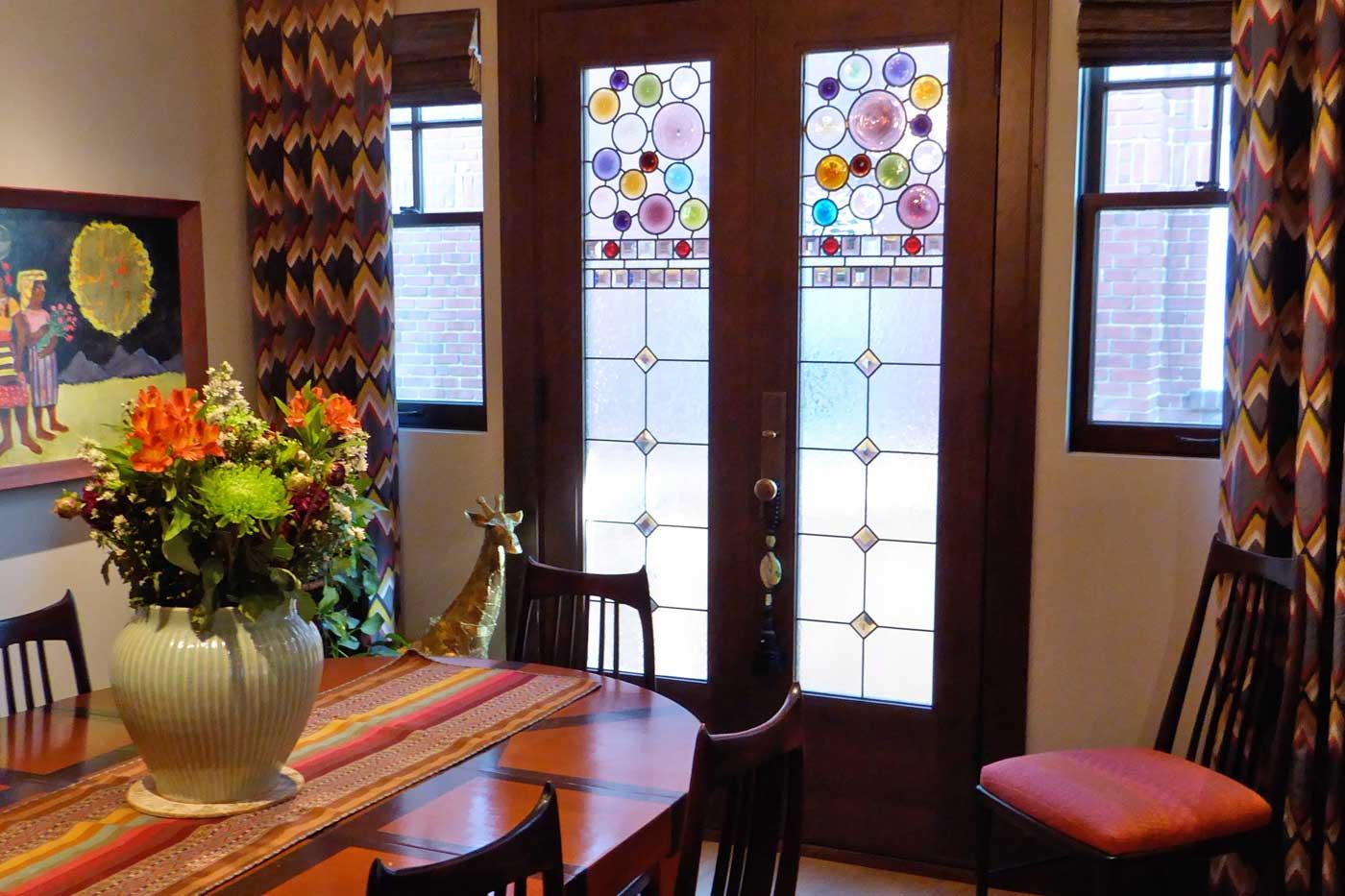 Roundels in custom stained glass doors by Ann Wolff.