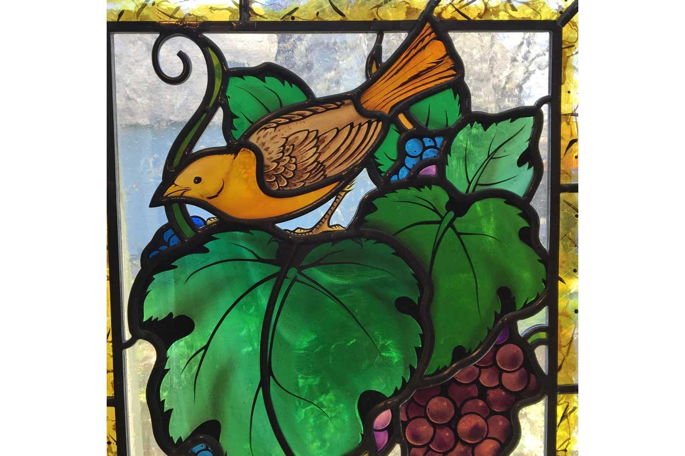 Stained glass painted by Indre McCraw beautifully accents Wolff's work.