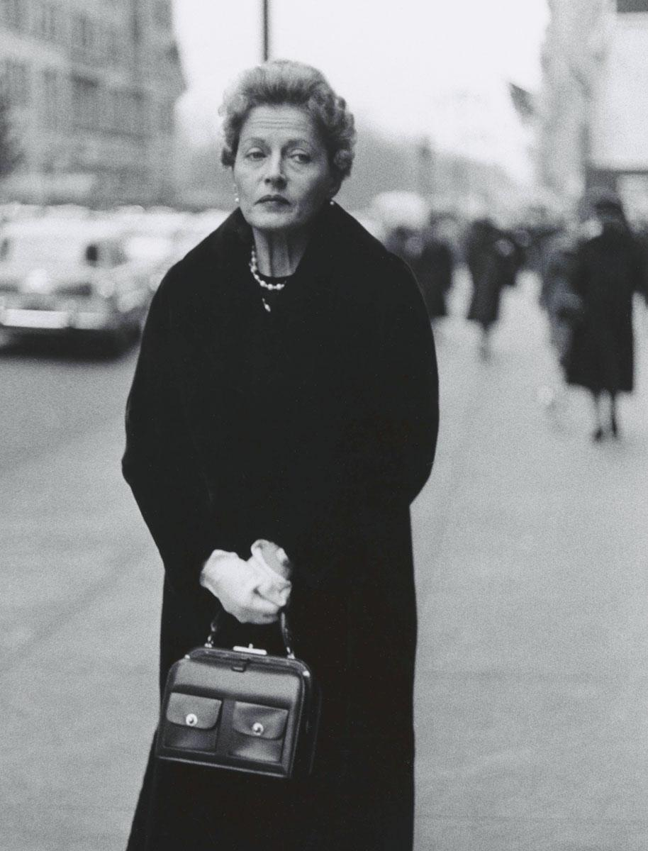 Woman with white gloves and a pocket book, N.Y.C. 1956