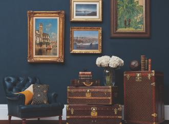 travel trunks and paintings