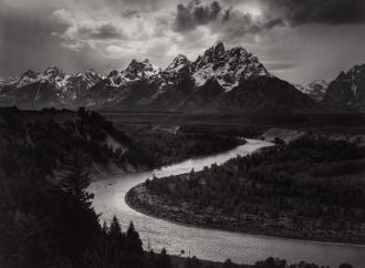 Ansel Adams black and white photograph of a river with mountains