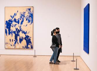 Visitors inside of SFMOMA, looking at paintings