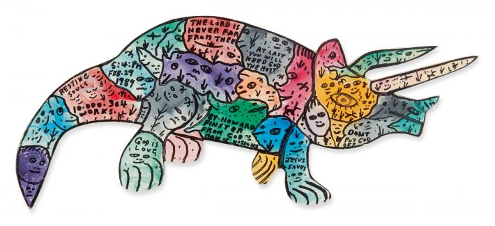 Howard Finster outline of a triceratops, multicolored filled with text