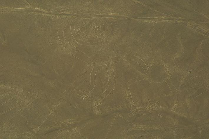 "Aerial view of the ""Monkey,"" one of the most popular geoglyphs of the Nazca Lines, 200 BC - 800 AD. Nazca Desert, Peru."