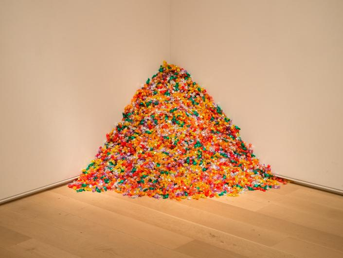Felix Gonzalez-Torres conceptual art work- a pile of colorfully wrapped candies piled in the corner of an art gallery