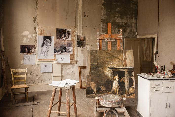 Andrew Wyeth Studio, with reproduction of Raccoon (1958) on the easel and reproduction drawings taped to the wall