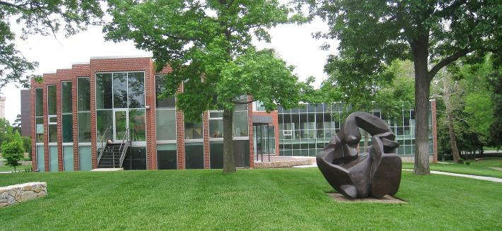 Kansas City Art Institute lawn with a large bronze organic sculpture and brick building