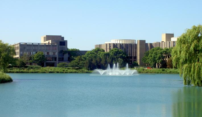 Northwestern campus, large buildings on a body of water with a fountain