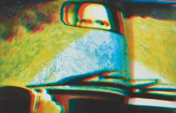 Tom McGrath print of eyes seen in a rearview mirror of a car
