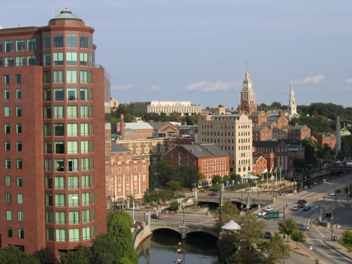 view of RISD from above- brick buildings along a river with a bridge