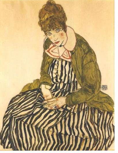 Egon Schiele portrait of Edith Shiele, in a black and white dress, seated on the floor, with a green sweater