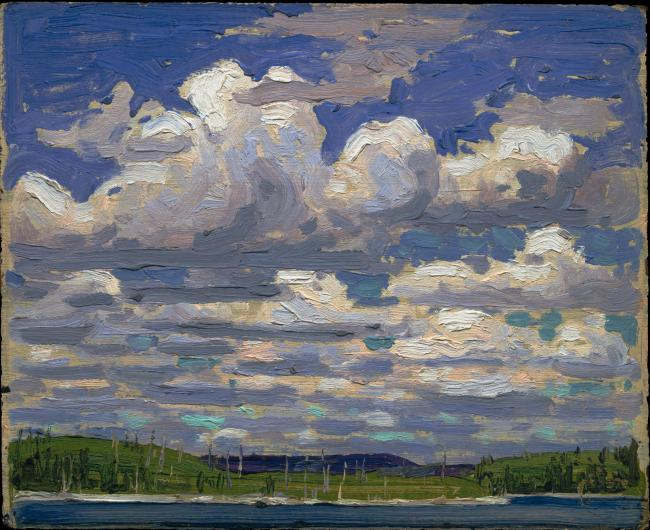 Tom Thomson landscape painting of a strip of coast with a large sky filled with clouds
