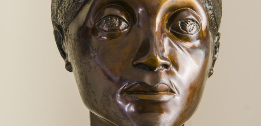 bronze bust of woman's head